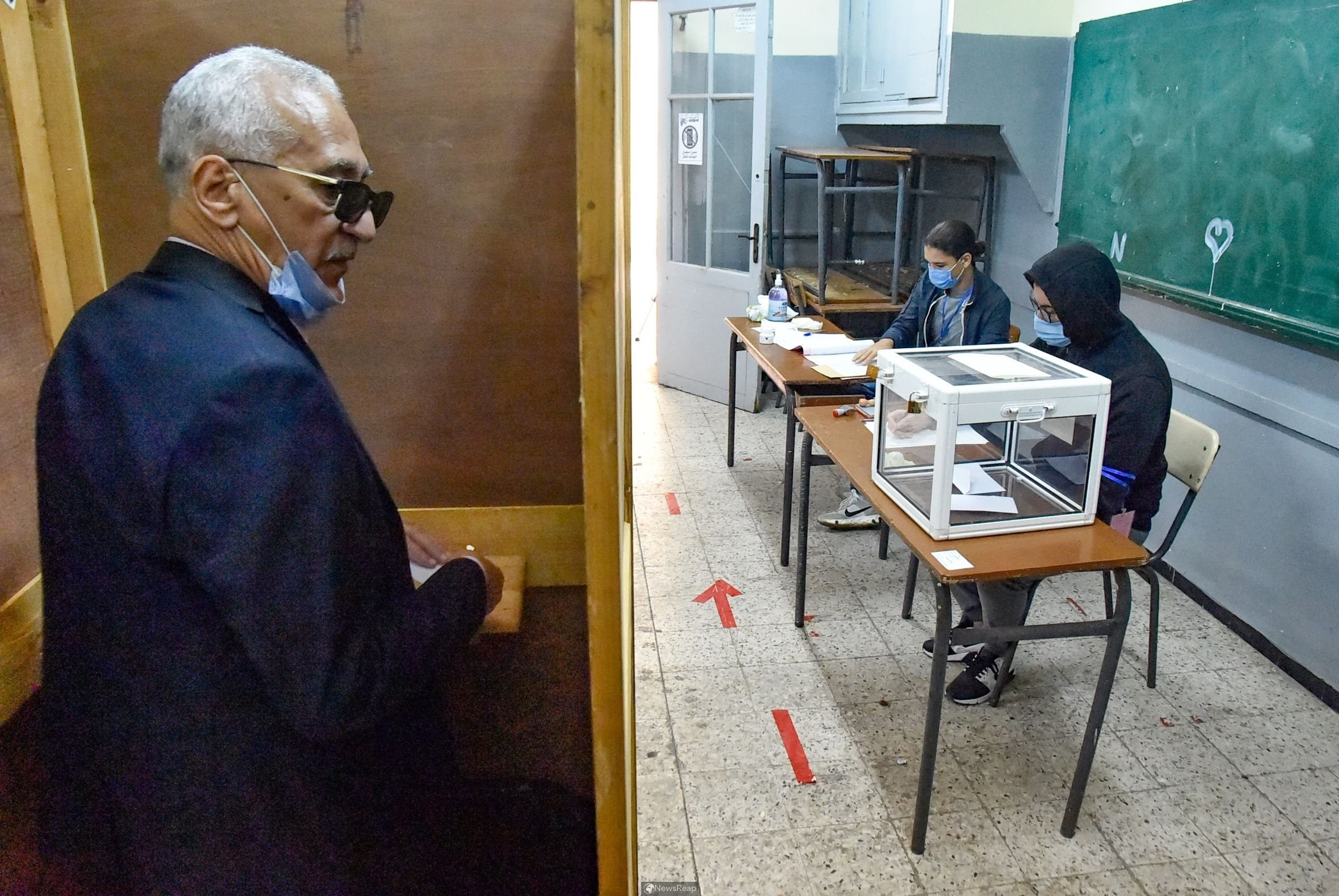 Algerians vote on constitution with president in hospital