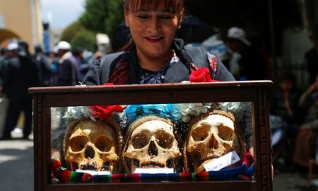Bolivians decorate skulls with sunglasses and cigarettes to honor the dead