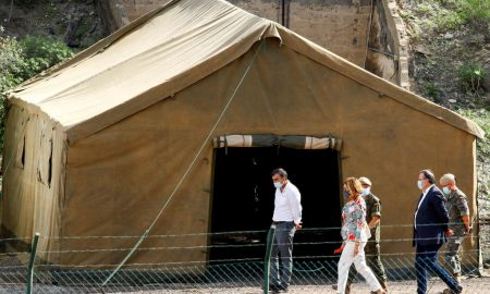 Spanish military sets up camp for migrants stranded at Canary Islands' harbour