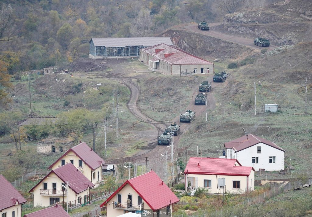Corpses and burnt-out cars line Karabakh road as Russian troops deploy