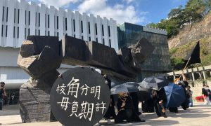 Campus march by Hong Kong graduates marks a year since university clashes