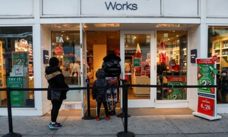 U.S. shoppers grab last-minute holiday gifts, pick up online orders in-store