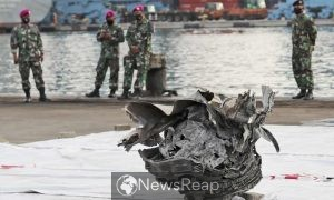 Indonesia says divers closing in on black boxes from crashed jet