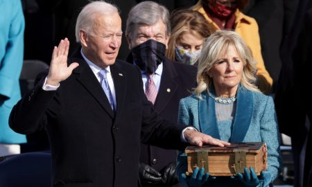 We must end this uncivil war, Biden says, taking over a U.S. in crisis