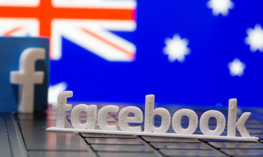 Undeterred by Facebook news blackout, Australia commits to content law
