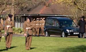 Military honors and fly-past mark funeral of Britain's Captain Tom