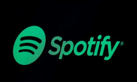 Apple goes to battle with Spotify in premium podcast push