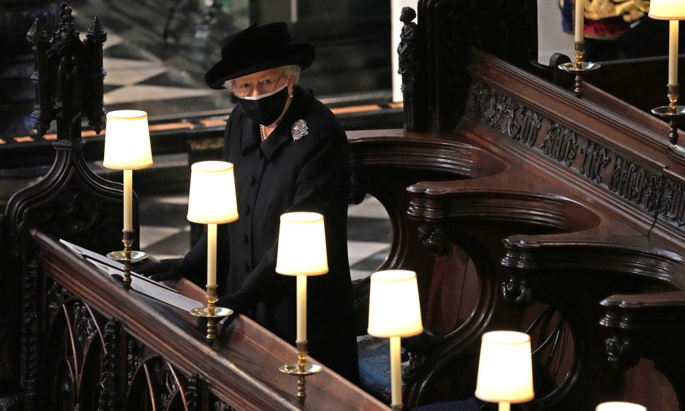 Queen Elizabeth stands alone as her strength Philip is laid to rest